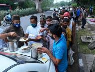 People Line Up to Receive Free Food at New Delhi Centers for Poor ..