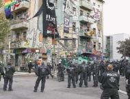 Dozens of police hurt in riots at Berlin's hold-out squat