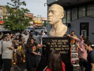 Neo-Nazi group name scrawled on New York George Floyd statue