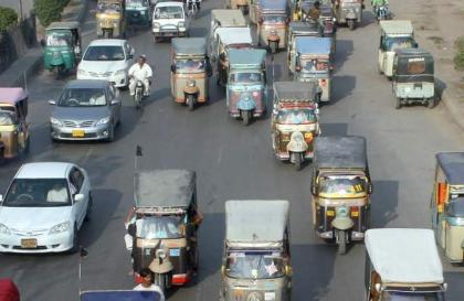 Rickshaw drivers stage protest rally against extortion at Railway station