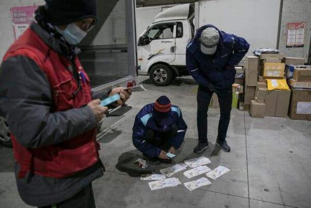 South Korean Couriers Embark on Industrial Action Over Work Overload - Reports