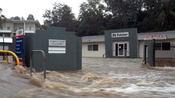 Man dies in flood as wild weather hits Australia