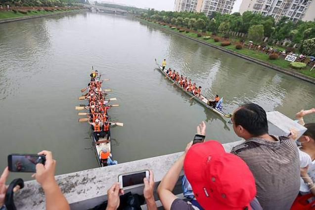 Red tourism flourishes during China's Dragon Boat Festival holiday