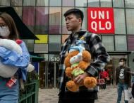 Uniqlo parent firm downgrades outlook despite earnings rebound