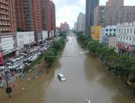 China evacuates tens of thousands as China storms spread north