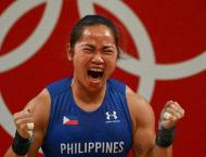 'So proud': Philippine weightlifter Diaz hailed for historic Olym ..