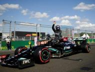 Hamilton defies boos to take Hungarian pole with 100th win in sig ..
