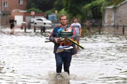 Belgian flood victims face long, grim summer clean-up