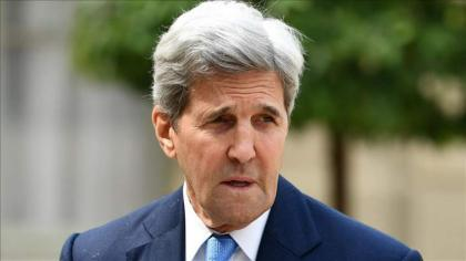 Kerry urges China to help solve climate challenge