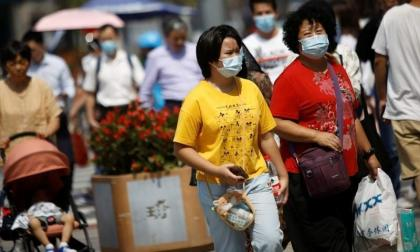 China's Nanjing tightens restrictive measures to stem spike in COVID-19 infections