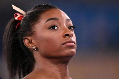 Biles's Olympic fate in balance as support pours in