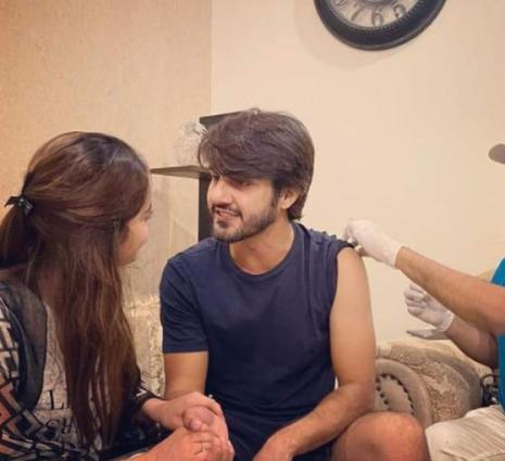 Ahsan Mohsin, supported by Minal Khan, gets COVID jab