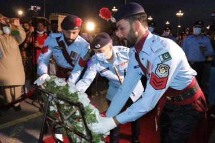 Islamabad policemen light-up candles to pay tribute to martyred colleagues