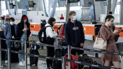 England eases Covid travel curbs