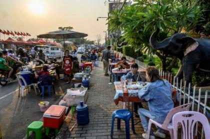 Laos locks down capital as Covid cases hit record high