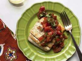 Fish In Tomato And Basil Leaves