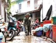 پٹنی، بینکاک سے 1000کلو میٹر دور قصبے میں تھائی فوج گشت کر رہی ہے۔