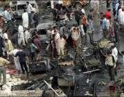 کربلا،عراقی شہر خودکش بم حملے کی جگہ پر کھڑے ہیں۔