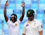 دبئی ٹیسٹ کے پہلے روز سری لنکن باؤلر پاکستانی اوپنر احمد شہزاد کو آؤٹ ..