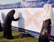 فیصل آباد: جماعت اسلامی کی کرپشن فری پاکستان مہم کے سلسلہ میں لگائے ..
