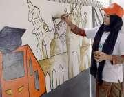لاہور: ایک طالبہ اورنج لائن میٹرو ٹرین کی پرموشن کے لیے دیوار پر پینٹنگ ..