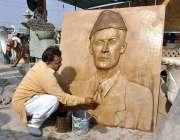 لاہور: ایک آرٹسٹ قائد اعظم کی تصویر کے فائنل مراحل طے کر رہا ہے۔