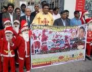 کراچی: پریس کلب کے سامنے رافا مشن انٹرنیشنل کے ارکان کرسمس امن ریلی ..