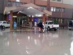 ABBOTTABAD: A view of rain water front of main entrance & Emergency Unit of Ayub Teaching Hospital due to Negligence of Management.