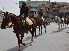QUETTA: Poliece horse patrol during protest call against India.