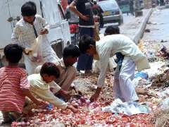 HYDERABAD: Children searching onions from the garbage thrown by vendors at Sabzi Mandi Road.