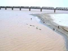 HYDERABAD: A view of River Indus filled with water after recent monsoon rains.