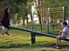 ISLAMABAD: Children enjoying on see-saw at a roadside park.
