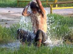 ISLAMABAD: A youngster bathing through leaked water pipe to get relief from hot and humid weather.