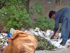 ISLAMABAD: A gypsy searching valuables from heap of garbage.