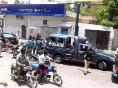 HYDERABAD: A large number of police officials gathered in front of a local bank after robbery.