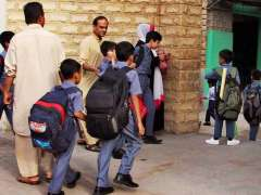 KARACHI: Students are seen coming to school after ending of summer vocations.