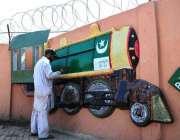 راولپنڈی: پی ایچ اے کا اہلکار پاکستان ڈے کے حوالے سے ٹرین کا ماڈل تیار ..