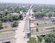 لاہور: میٹرو ٹرین گزارنے کے لیے پیرا شوٹ کالونی سے ملحقہ ریلوے یارڈ ..