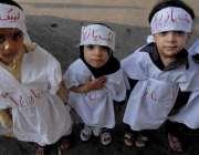 راولپنڈی: تحریک نفاذ جعفریہ کے زیر اہتمام ریلی میں شریک بچے۔