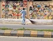 راولپنڈی: آرٹس کالج کے باہر طلبہ کی طرف سے بنائی جانے والی پینٹنگ کی ..