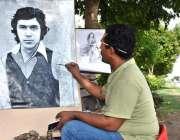 لاہور: ایک آرٹسٹ سڑک کنارے بیٹھا عمران خان کی جوانی کی تصویر بنا رہا ..
