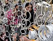 راولپنڈی: محرم الحرام کے حوالے سے دکاندار نے سامان سجا رکھا ہے۔