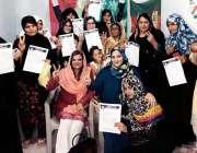 کراچی: پی ٹی آئی وومن ونگ کراچی کی جانب سے گزری میں خواتین عہدے داروں ..