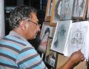 کراچی: ایک آرٹسٹ پینٹنگ بنانے میں مصروف ہے۔