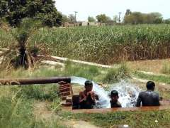 BAHAWALPUR: Children bathing at tube-well to get some relief from scorching hot weather in the city.