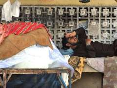RAWALPINDI: An ice vendor taking a nap during a hot weather in the city.