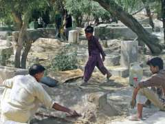 BAHAWALPUR: People busy in making earth paste to repair graves of their beloved ones in graveyard on the eve of Moharram ul Harram.
