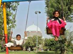MULTAN: Children enjoying swing at local park.
