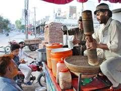 MULTAN: A vendor preparing traditional summer drink (Sardai) for customers at his roadside Setup.