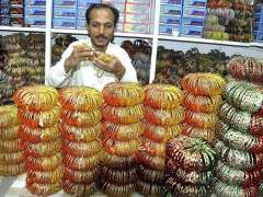 HYDERABAD: A worker giving final touch to Bangles at Bangle Market in preparation for Eidul Fitr.